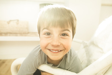 Portrait of a smiling and happy child at home. Child with joyful expression
