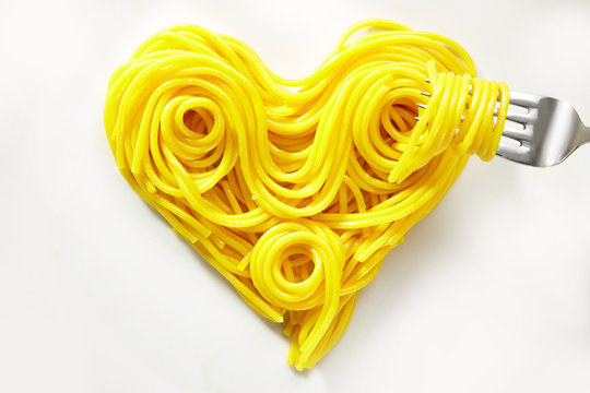 Decorative heart of coiled cooked spaghetti