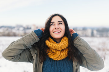 Heart melting winter portrait of pretty young woman awaiting Chr