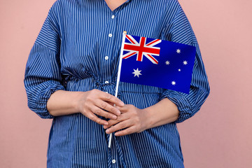Australia flag. Close up of a woman's hands holding Australian flag.