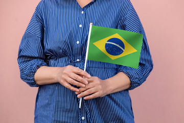 Brazilian flag. Close up of a woman's hands holding Brazil flag.