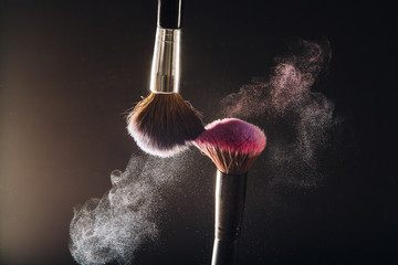 Makeup brush on black background