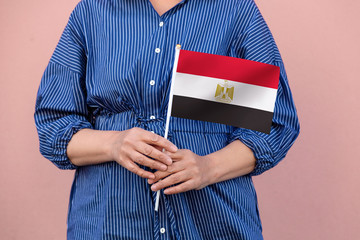 Egypt flag. Close up of a woman's hands holding EgyptIan flag.