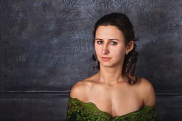 Portrait of a beautiful brunette with a deep neckline.