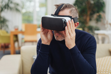 Middle-aged man wearing virtual reality glasses