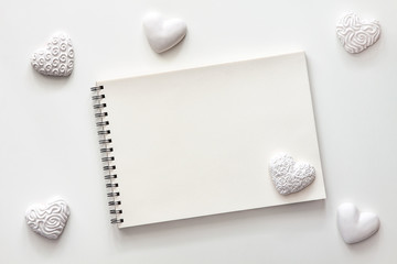 White background with space for text. Valentine's background with white hearts. A photo in a high key. Sketchpad mockup