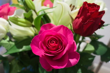 Bouquet of flowers with pink rose in foreground
