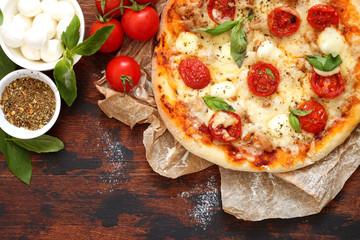 Homemade Pizza Margarita with Tomatoes, Basil and Mozzarella Cheese