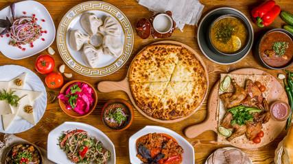Georgian cuisine foodset from khachapuri, khinkali, pkhali, dolma, satsivi top view