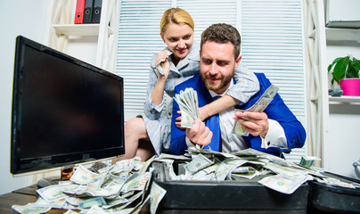 Huge profit concept. Financial success. Counting money profit. Man businessman and woman secretary with pile dollar banknotes. Profit and richness concept. Businessman near cash dollars profit