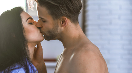 Passionate kiss concept. Couple in love kissing with passion. Man and woman attractive lovers romantic kiss. Seduction and foreplay. Celebrate valentines day. Sensual kiss of lovely couple close up