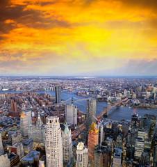Wall Mural - Brooklyn, Manhattan and Williamsburg Bridge at night, amazing aerial view of New York City - USA