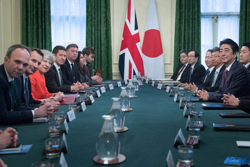 British Prime Minister Theresa May sits with Japanese Prime Minister Shinzo Abe ahead of a bilateral meeting in 10 Downing Street, London