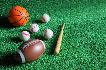 Sports accessories. sticks, balls on Green background.