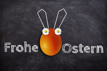 Frohe Ostern ! Fröhliches Osterei mit Hasenohren und Spruch