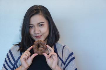 happy woman eating donut , she love donut dessert , fat girl's enjoy eating