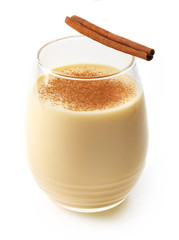 Eggnog with cinnamon stick isolated on white background