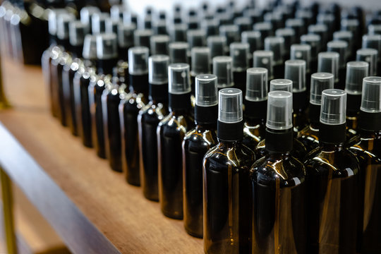 Set of glass dark brown bottles  for cosmetics and medicine products. Minimalism