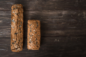 top view of chrono breads on wooden brown background with copy space