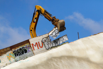 U.S. workers use machinU.S. workers use machinery to replace the metal sheets of the border fence between the U.S. and Mexico, as seen from Tijuana