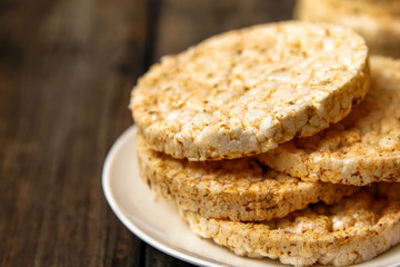 Salty rice crackers galettes with spices. Tasty salty healthy biscuits.