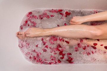 Romantic Valentines day bath with rose petails, woman in home spa, luxury self care