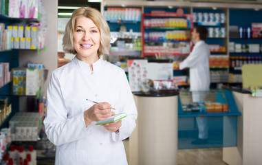 female pharmacist   posing in drugstore
