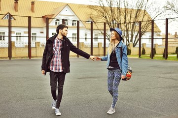 Beautiful young couple walking together