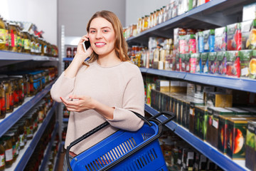Female talking by phone in grocery