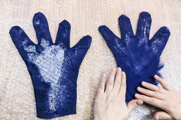 craftsman puts fibers of back side of glove