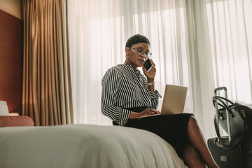 CEO on business trip working from hotel room