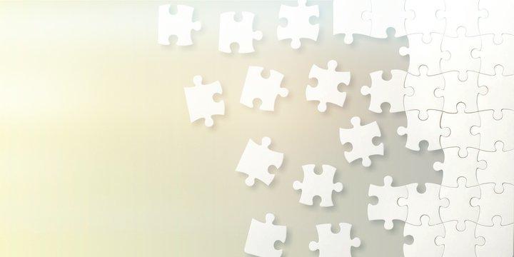 White puzzle pieces on grey background
