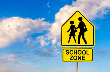 SCHOOL ZONE street sign with sky and clouds background