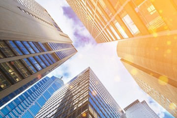 Modern office glass buildings over sky background