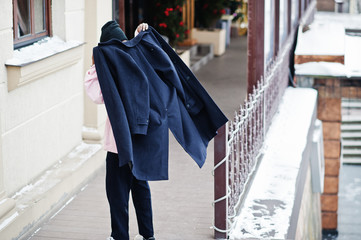 Back of stylish urban style african american man wear black coat at winter.