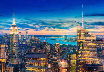 a magnificent aerial panoramic view of Manhattan with sunset