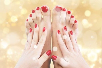 Closeup photo of a beautiful female feet with pedicure and hands