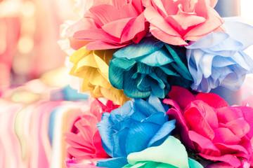 Closeup of colorful handmade paper/fabric flowers used for Dia de los Muertos