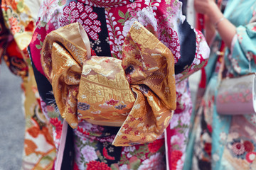 Midsection of women in kimono standing outdoors