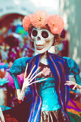 Traditional catrina doll decorated for Dia de los Muertos/Day of the Dead celebration