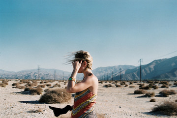 Side view of woman standing in Joshua Tree National Park