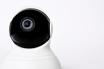 White modern security camera for remote control on a white background. Isolated on a white background. Security and surveillance.