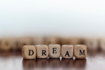 Dream word on wooden cubes. With copy space
