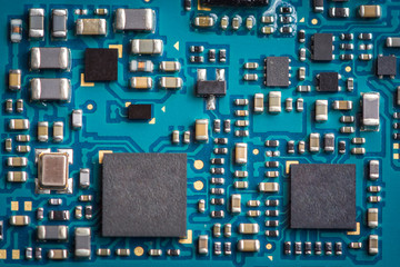 Close up zoom shot of mobile phone mother board with microchips and circuits.