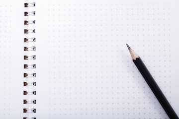 Wooden pencil put on notebook with copy space. Pencil on page, the blogger instrument, desktop of businessman