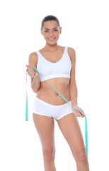 Slim woman with measuring tape on white background. Weight loss