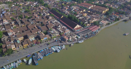 Aerial view panorama of Hoi An old town or Hoian ancient town. Royalty high-quality free stock video footage top view rooftop of street walking in Hoi An city. HoiAn city is UNESCO world heritage site