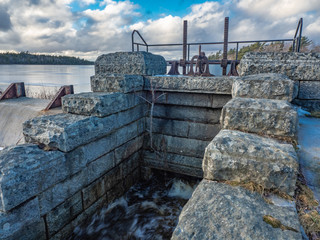 Water dam flow gate made of stone.