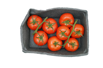 Tomatoes in cardboard box