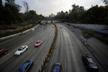 Cars move on a road in Mexico City